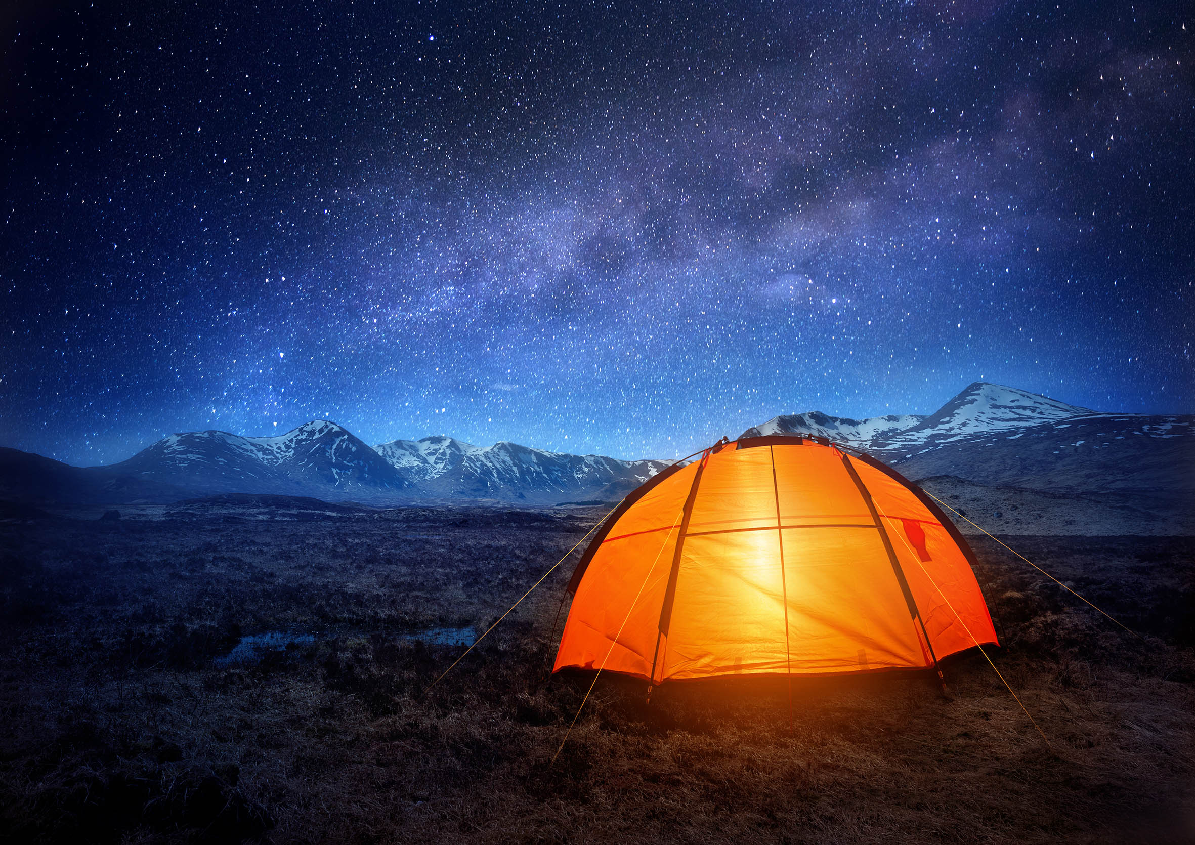 The sky at night during wild camping | Land Rover Explore